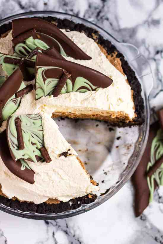 Overhead shot of a mint chocolate cream pie with a slice missing.