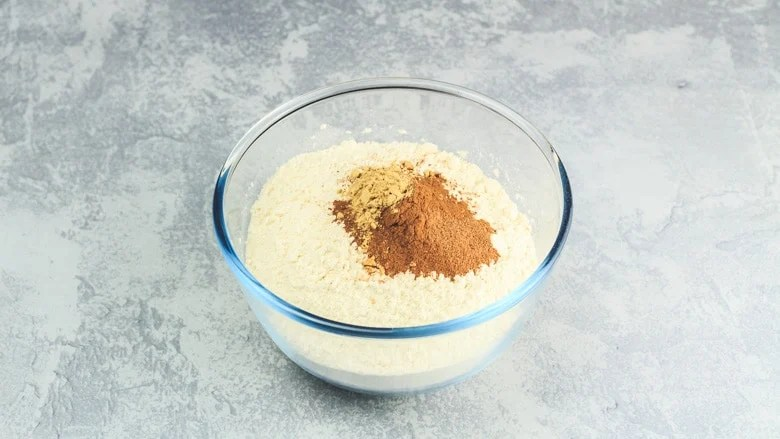 Dry ingredients in a glass mixing bowl for Apple Cinnamon Muffin recipe
