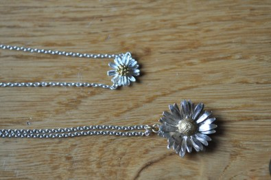 From above: Daisy Bracelet - Estella Bartlett; Daisy Necklace - Alex Monroe