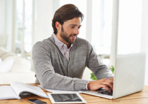 An attractive businessman working on his laptop