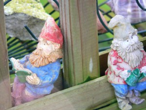 A Dutch girl feels right with gnomes in her garden, watching over things.