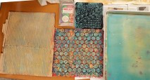 Textures that can be pressed onto the plate after the paint is rolled on.: corrugated cardboard, bubble wrap, and a commercial texture plate. Also: Gelli Arts small commercial plate.