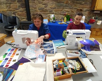 Monica and Kelsey go to town with their quilting. A messy table is inevitable with supplies everywhere!