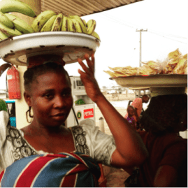 """Nigerian roadside hawker in traditional wrapper. Also called a lappa, or pagne. This is how Azaro's """"Mum"""" was described."""
