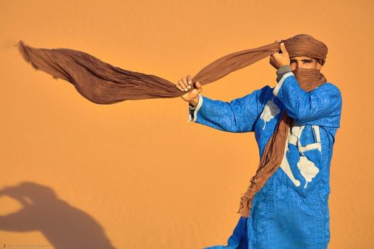 Young Moroccan Man Tying Turban