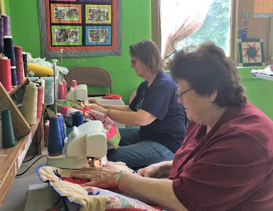 """Angel Quilters donate children's quilts for """"physical, mental, spiritual and emotional comfort"""""""