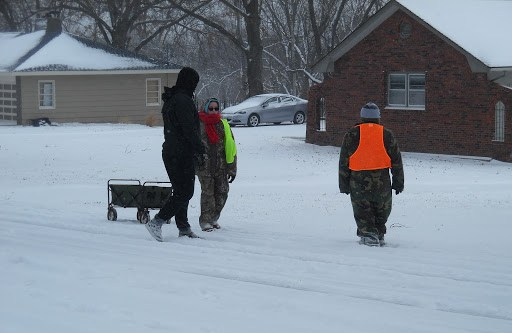 Through rain, sleet or snow, Boy Scout Troop #46 does its part for the Red Bridge community