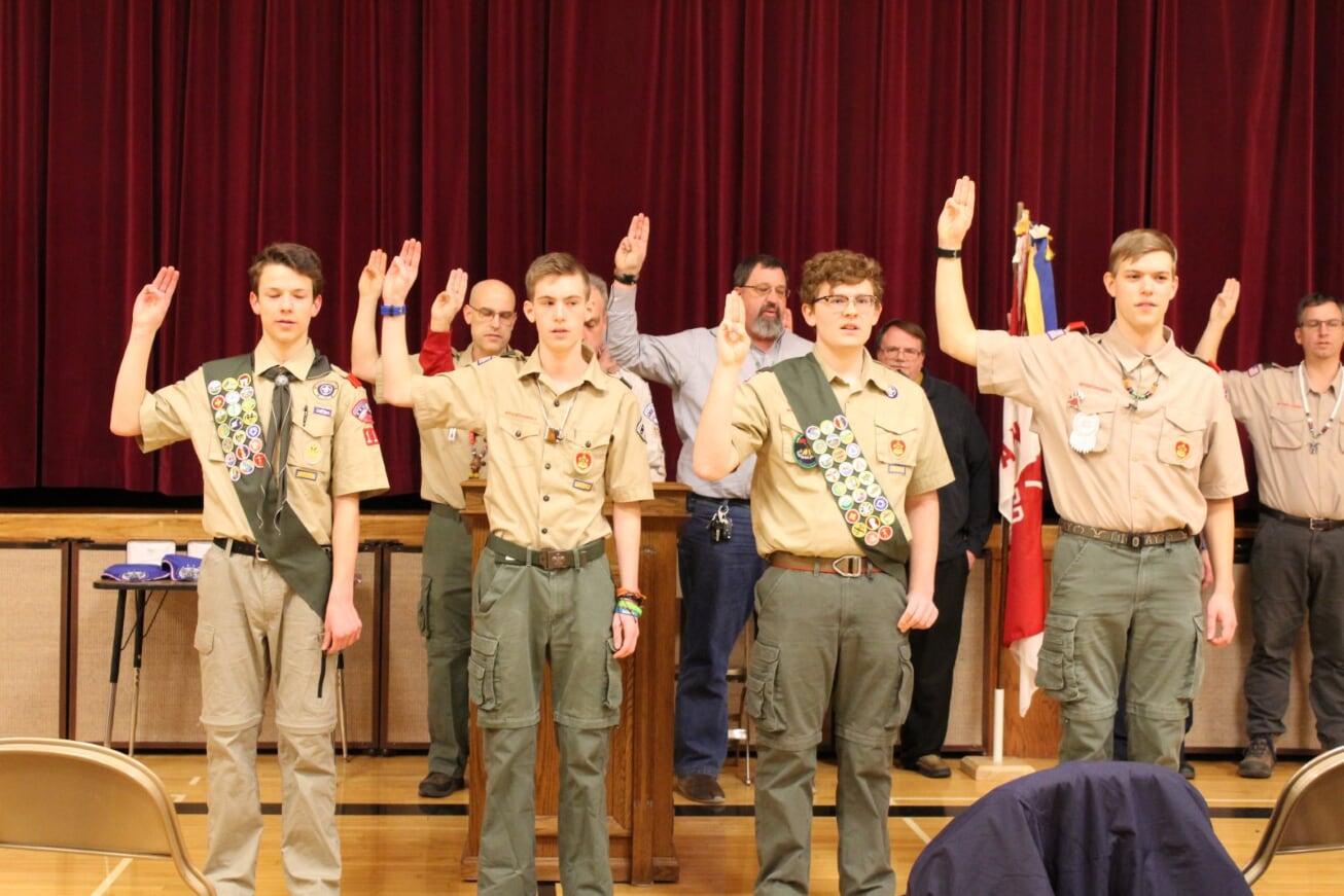 Boys earn Eagle Scout badges in bittersweet ceremony