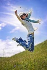 girl jumps for joy