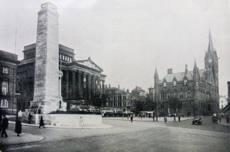 Cenotaph to the Great War, ancient Market Square, and soaring Town Hall in the distance.