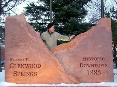 Martin Cooney, author martincooney.com, with Glenwood Springs Entrance Sign