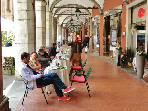 Lunchtime Arcade Crowd, Central Pisa, Along The North West Tuscan Way by Martin Cooney