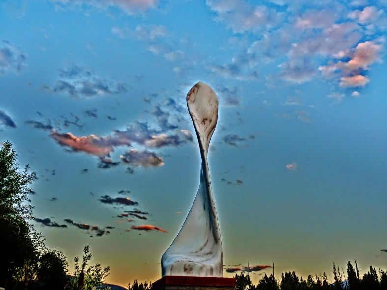 Maypole, takes to the sky on a sculpture garden plinth. Curvilinear Colorado Yule Marble Sculpture by Martin Cooney