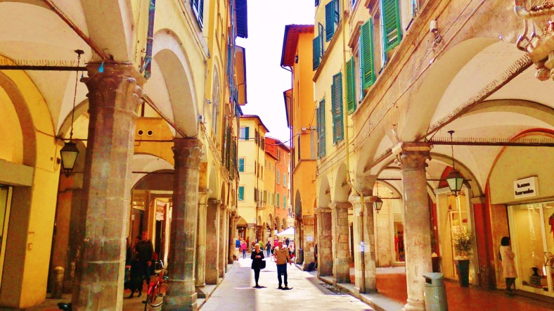 Arcade Stroll, Streetscape, Downtown Pisa, Along The North West Tuscan Way by Martin Cooney