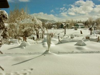 Maypole stands half buried by new fallen snow. Sculpture Garden, Woody Creek CO