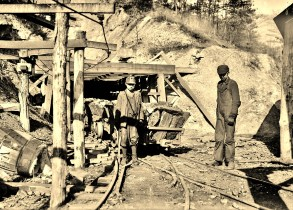 Miners, young boys at entrance to mine (2)