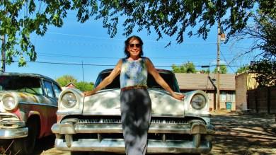 Kris Cooney poses with vintage car, Delta, Colorado