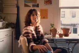 Kris Cooney, owner KMJ COONEY GALLERY, in her kitchen in Portland, 1980