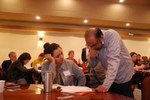Vijay Balakrishnan, right, explains budgeting techniques to Alexa Senter at the Deluxe business semina