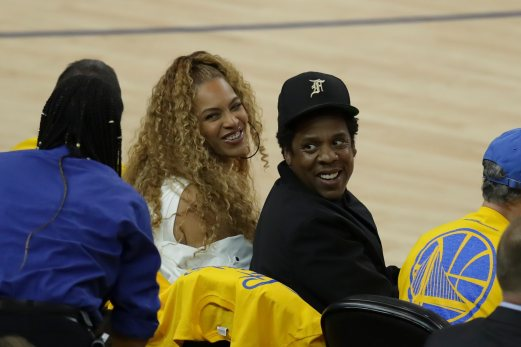 Queen B & Jay Z all smiles Photos by Kym Fortino Martinez News-Gazette