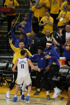 The bench go crazy after Klay's three pointer Photos by Kym Fortino Martinez News-Gazette