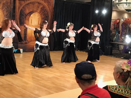 Sister Sirens, of Martinez, dance on the ballroom stage at Rakkasah West, the bellydance festival in Concord.