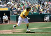 Oakland A's vs Houston Astros Khris Davis runs out a base hit Photos by Gerome Wright Martinez News-Gazette