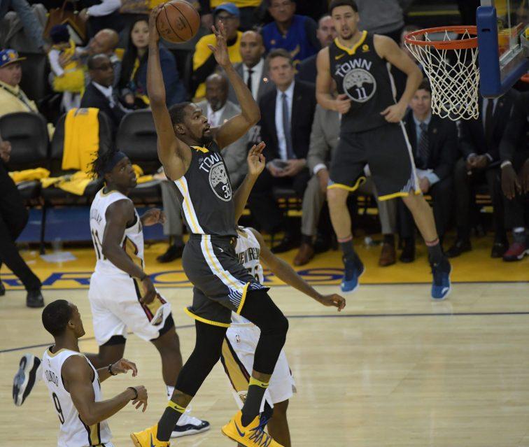 Durant splits through the Pelicans defense. Photos by Gerome Wright Martinez News-Gazette