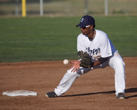 Luis Perez fields a throw at second base.