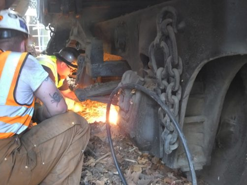 Taylor Heavy Haul Crew Chief -- Dusty --Cutting the Chocks off that were Welded to the Tracks Under the Car