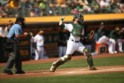 Oakland A's vs New York Yankees #21 C Jonathan Lucroy Photos by Tod Fierner ( Martinez News-Gazette )