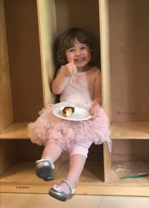 My two-year-old granddaughter Daisy enjoying Doughnut Sunday.