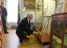 Congressman Mike Thompson inspects the display of the late Judge Richard Arnason items at the Martinez Museum