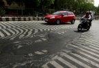 Melting asphalt i Delhi