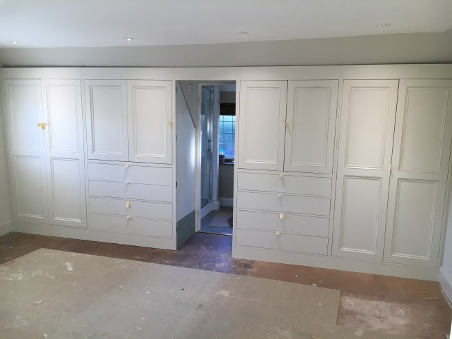 Fitting wardrobes into position