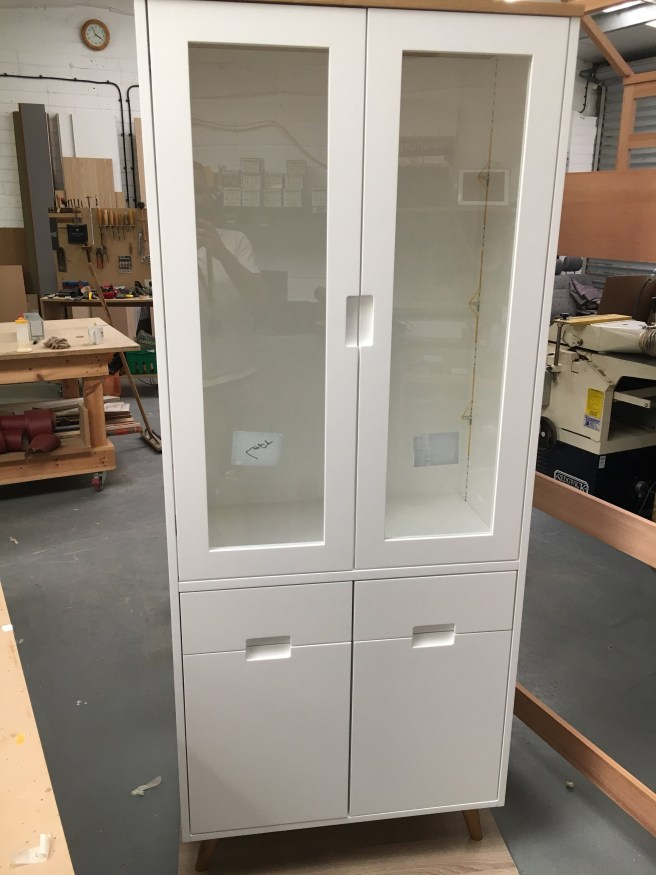 Free standing cabinet sprayed white