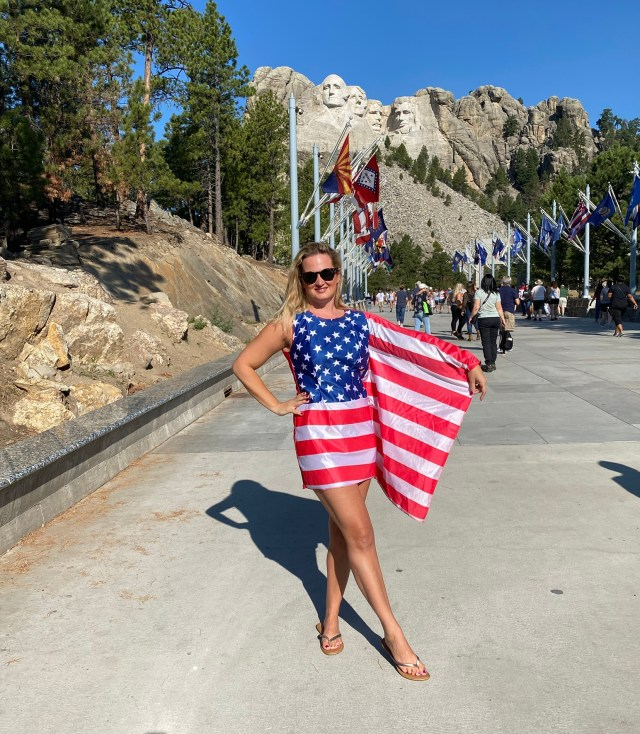 American Flag in front of Mount Rushmore