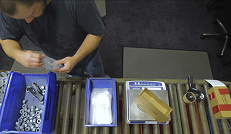 employee baging fastener parts for sub-assembly