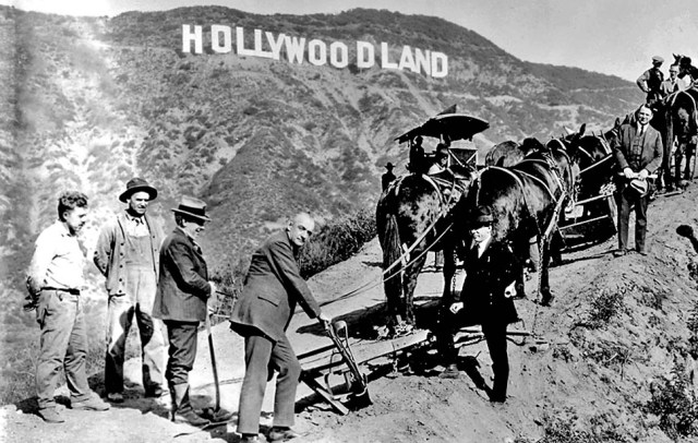 Hollywoodland subdivision groundbreaking publicity photo includes a plow, mules and surveyors, circa 1923