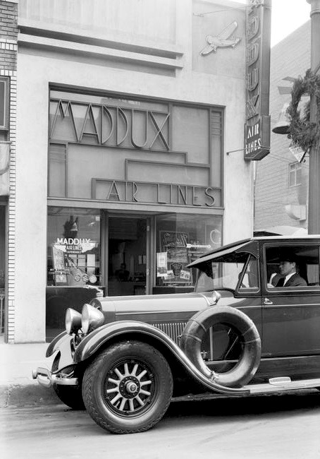 A chauffeur keeps the Lincoln idling outside the Maddux Air Lines office, 636 S. Olive St, Los Angeles, 1929