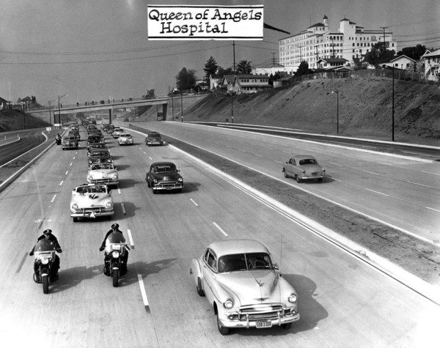 A motorcade travels over a newly opened segment of the 101 Hollywood Freeway in 1950.