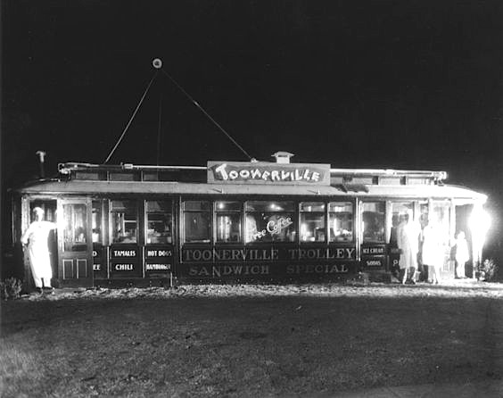 Toonerville Trolley sandwich shop located at 1635 W. Manchester Avenue. Sign reads- 'Sandwich Special' and 'Free Coffee' Los Angeles, 1920