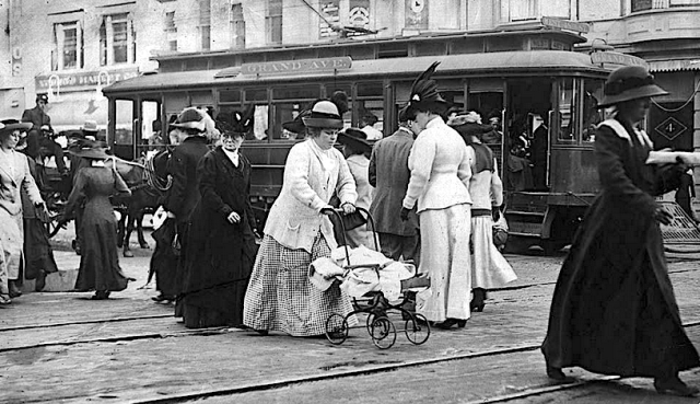 Grand Ave pedestrians get off the Grand Ave streetcar, downtown Los Angeles, circa 1900
