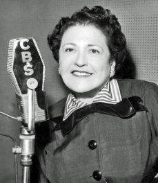 "Louella Parsons takes to the airwaves on CBS's ""Hollywood Hotel"" radio show"