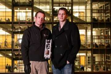 Nigel Syrotuck (left) and Justin Curran pose with an engineering model of a satellite that placed third in a Canada-wide competition.