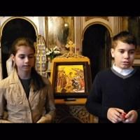 Doi frățiori frumoși cântând Hristos a înviat