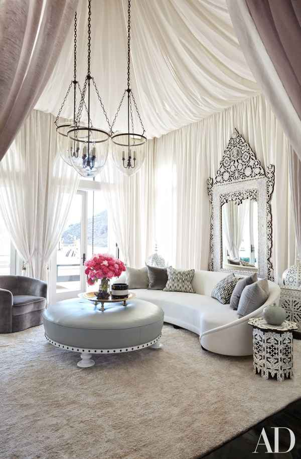 Khloe Kardashian's living room designed by Martyn Lawrence Bullard. Zebide baltic indoor fabric on pillows