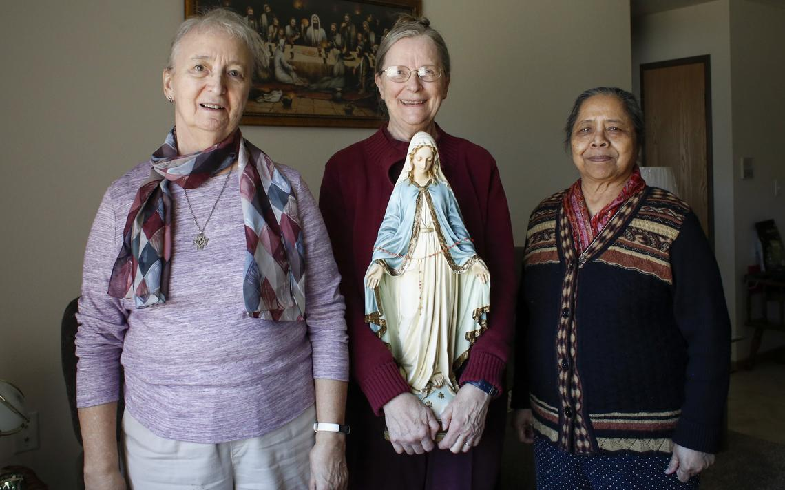 Presentation Sisters Lorraine Schmaltz (from left), Bernadette Trecker and Rose Lima D'Costa stand with the statue of Mary from the Sacred Heart Convent on Monday, March 22, 2021, in Sister Schmaltz' south Fargo home. Michael Vosburg / Forum Photo Editor