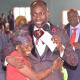 Apostle Suleman help a woman