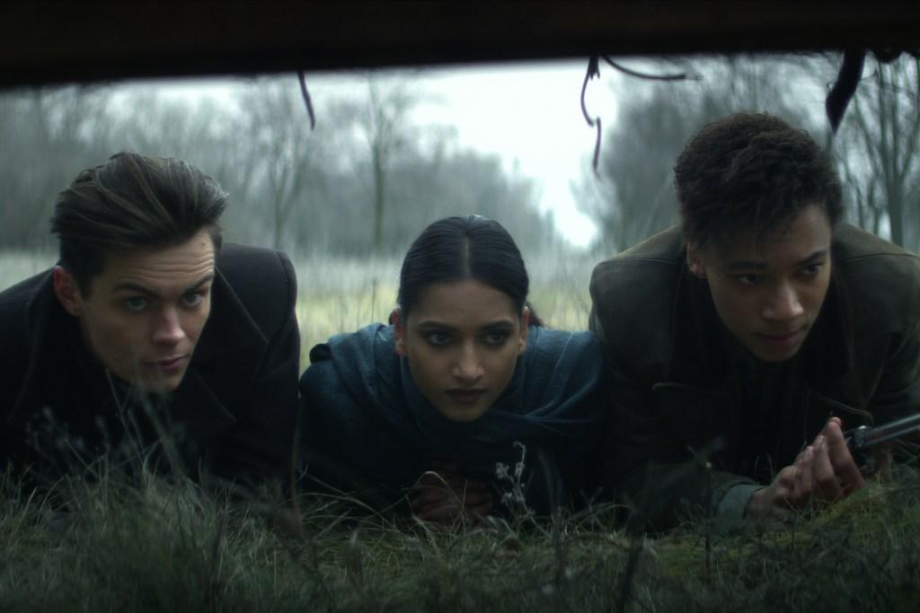 Freddy  Carter as Kaz Brekker, Amita Suman as Inej Ghafa and Kit Young as Jesper Fahey in Shadow and Bone.